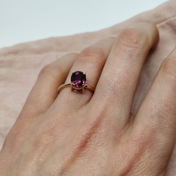 Rhodolite Garnet Rose Gold Engagement Ring on Ring Finger